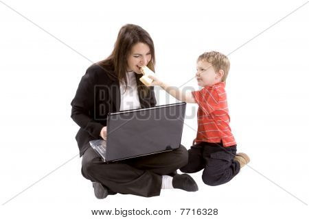Boy Feeding Mom