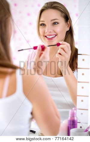 Beauty girl portrait with make up in bathroom