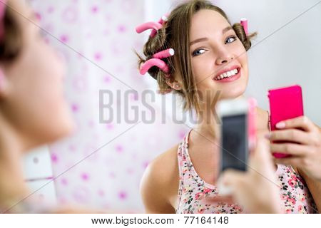 Teen girl making self in bathroom  front mirror
