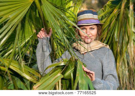Woman With Headscarf Next To Palms