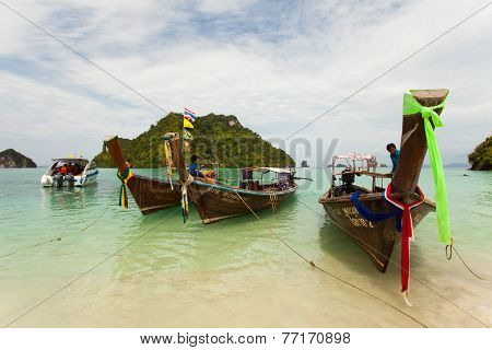 Traditional long tail boats with thai island