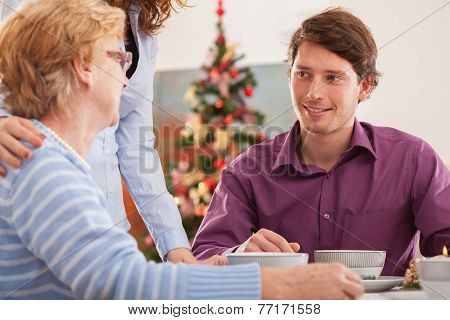 Man Talking With His Grandmother