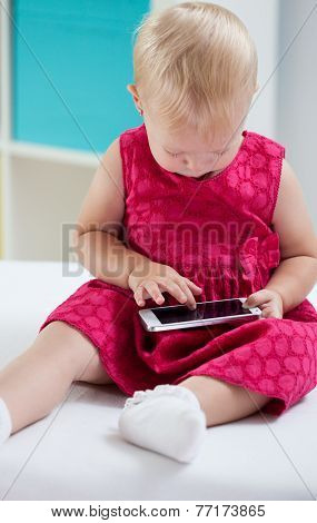 Little Girl Playing With Tablet