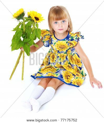 Charming girl in a bright dress.