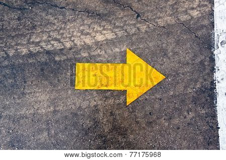 arrow on the asphalt road