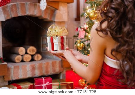 Pretty girl offering presents