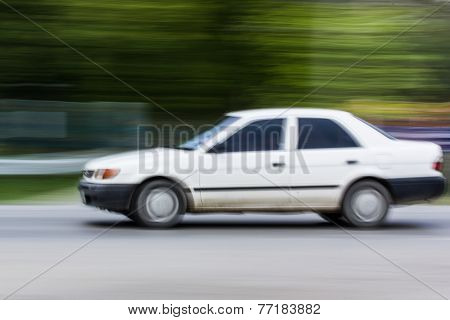 White Car Speeding In Road