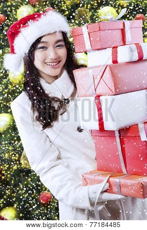 Girl With Gifts Near Christmas Tree