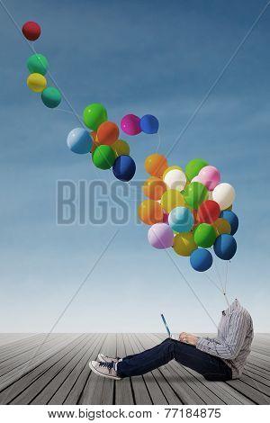 Highschool Student With Balloon Head