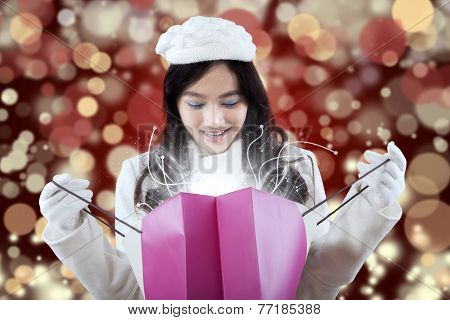 Lovely Girl Looking At Christmas Surprise
