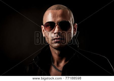 Dark Photo Of A Mysteryous Handsome Young Man With Sunglasses
