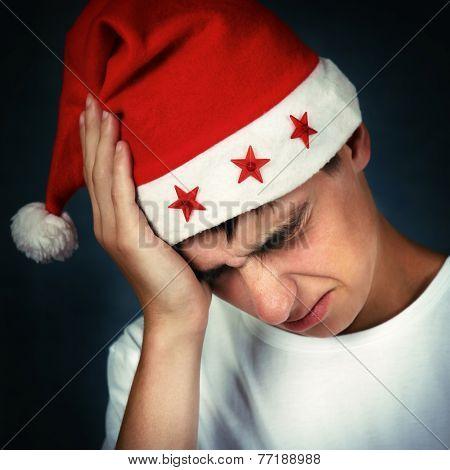 Painful Teenager In Santa Hat