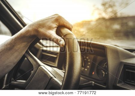 Hand Holding The Wheel.