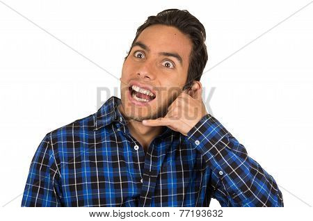 young handsome man wearing a blue plaid shirt gesturing call me