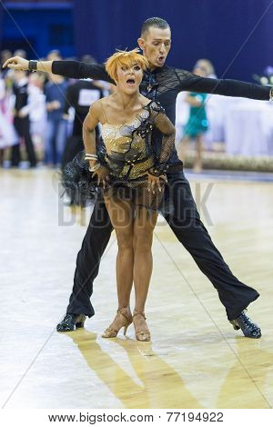 Minsk-belarus, October 4,2014: Unidentified Professional Dance Couple Performs Adult Latin-american