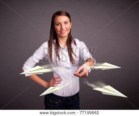 Beautiful young lady throwing origami airplanes