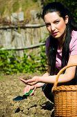 Farmer Woman Holding Soil