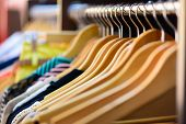 foto of boutique  - Variety of clothes hanging on rack in boutique - JPG