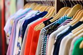 stock photo of boutique  - Variety of clothes hanging on rack in boutique - JPG
