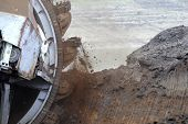 foto of collier  - Large excavator digging coal at surface coal mine - JPG