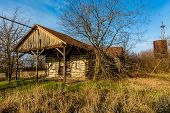 stock photo of shacks  - Abandoned Old Country Store or Shack in Oklahoma Made of Logs - JPG