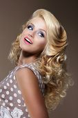 foto of aristocrat  - Happy Woman with Frizzy Blond Hairs Looking Up - JPG