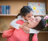stock photo of hispanic  - Hispanic mother and little daughter playing at home - JPG