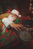 foto of cozy hearth  - Santa Claus  sleeping at home near Christmas tree and  resting by his fireplace - JPG