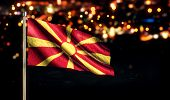 foto of macedonia  - Republic of Macedonia National Flag City Light Night Bokeh Background 3D - JPG