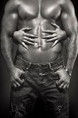 picture of hot couple  - Hot couple at night woman hands embracing sexy man abs black and white - JPG
