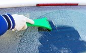 foto of scrape  - scraping the windshield of a car at winter - JPG