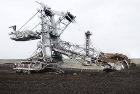 picture of collier  - Large excavator digging coal at surface coal mine - JPG