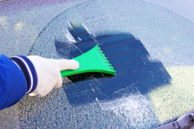 picture of scrape  - scraping the windshield of a car at winter - JPG