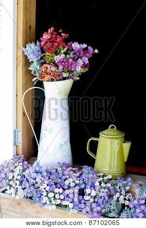 Beautiful Flowers In White Jug On Wooden Window