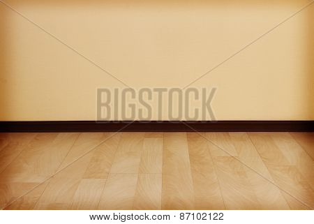 Empty Room With Clean Wall And Wooden Floor.