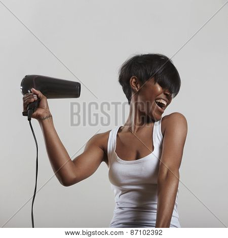 Girl Have Fun With A Hair Dryer