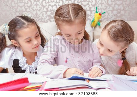 Small girls studying together