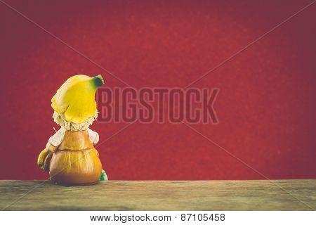 Ceramic Doll Sit On Wood