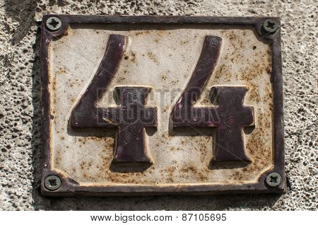 Old retro cast iron plate number 44