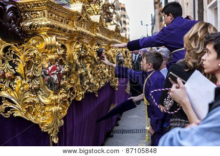 Boys Tries To Touch The Skirt Of The Throne To Have Good Luck, Popular Tradition In Andalusia, Easte