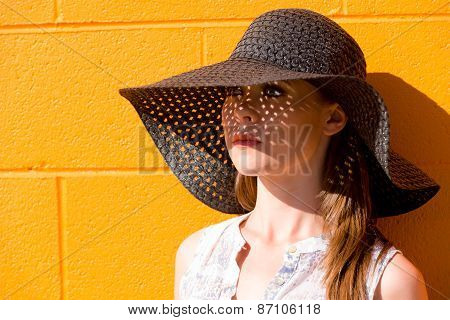 Portrait Of Attractive Young Lady Wearing Black Straw Hat