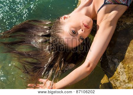 Attractive Model Relaxes With Hair Floating In Small River