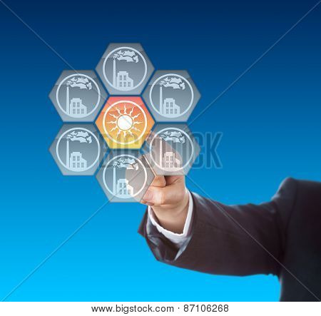 Business Hand Activating Solar Power Icon On Blue