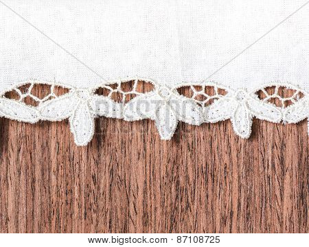 Closeup Of Wooden And Lacy Napkin Background