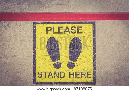 Please Stand Here Foot Sign Or Symbol On The Floor