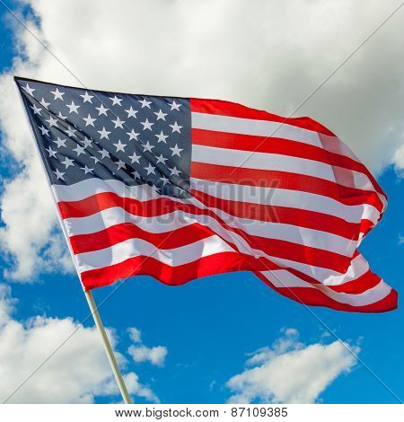 Usa Flag And Cumulus Clouds Behind It