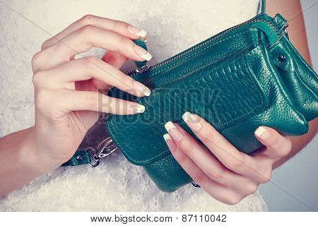 Female Hands With Manicure With Handbag
