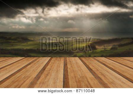 Stunning Sun Beams Over Big Moor In Peak District National Park England With Wooden Planks Floor