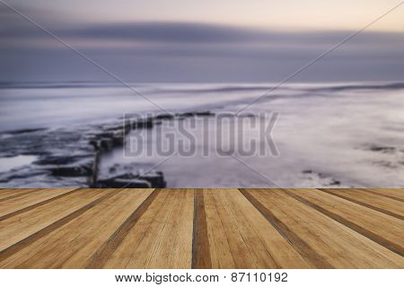 Beautfiul Vibrant Sunset Over Kimmeridge Bay Jurassic Coast England With Wooden Planks Floor