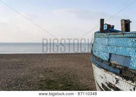 Old Abandoned Fishing Boat On Beach With Deliberate Shallow Depth Of Field